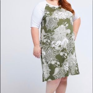Dress New With Tags Never Worn.  Fun and comfy.